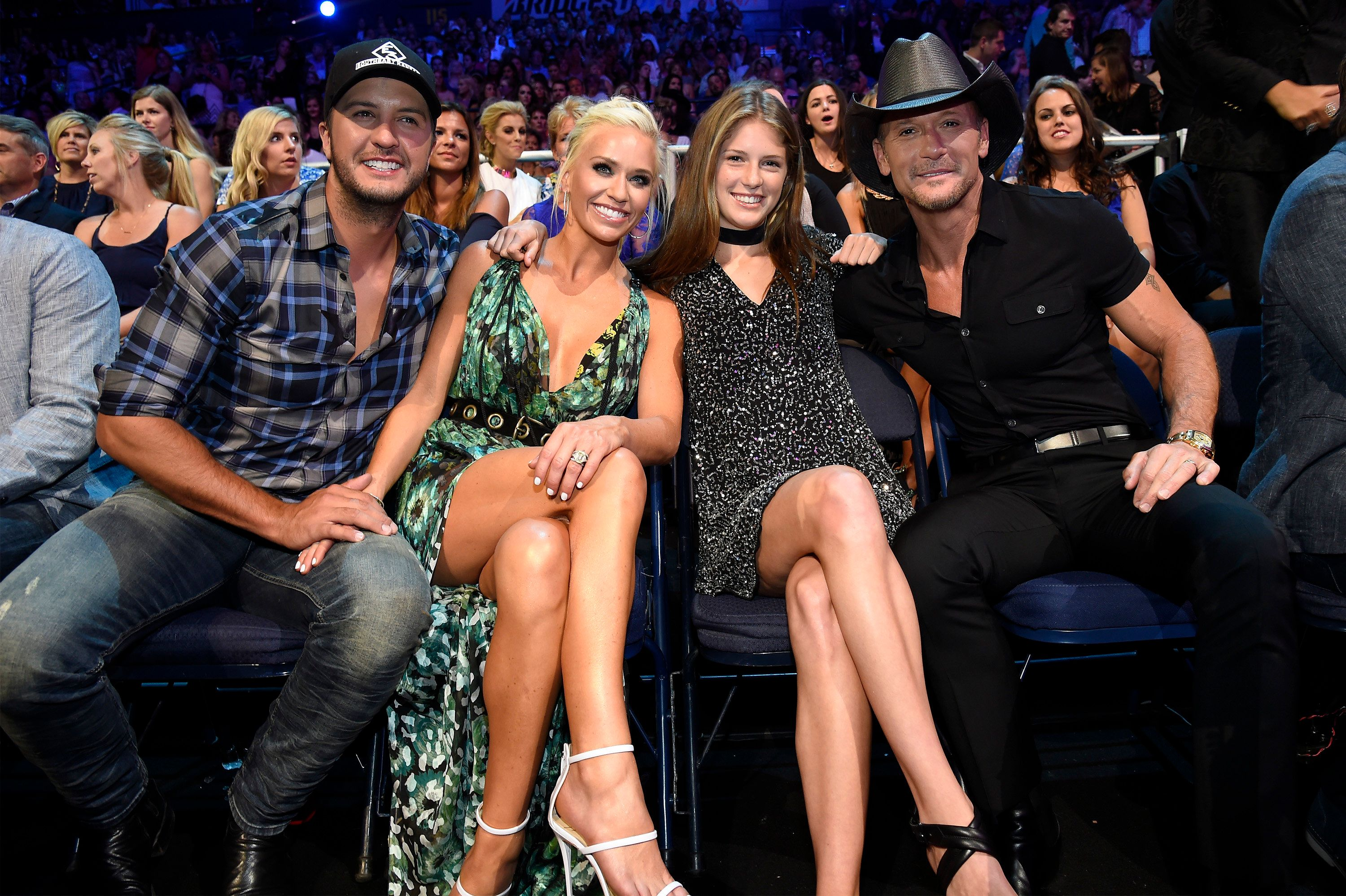NASHVILLE, TN - JUNE 08: Singer-songwriter Luke Bryan, Caroline Boyer and singer-songwriter Tim McGraw attends the 2016 CMT Music awards at the Bridgestone Arena on June 8, 2016 in Nashville, Tennessee.  (Photo by Kevin Mazur/WireImage)