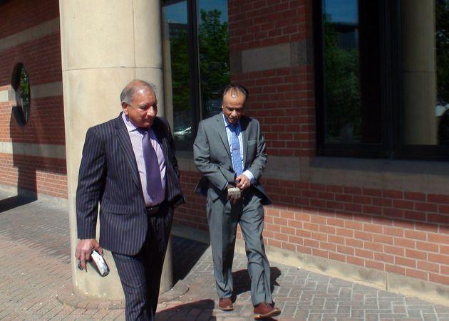 Restaurant owner Mohammed Zaman (right) leaves Teesside Crown