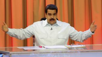 "Venezuela's President Nicolas Maduro speaks during his weekly broadcast ""En contacto con Maduro"" (In contact with Maduro) at the Miraflores Palace in Caracas, Venezuela, May 31, 2016. Miraflores Palace/Handout via REUTERS ATTENTION EDITORS - THIS IMAGE WAS PROVIDED BY A THIRD PARTY. EDITORIAL USE ONLY."