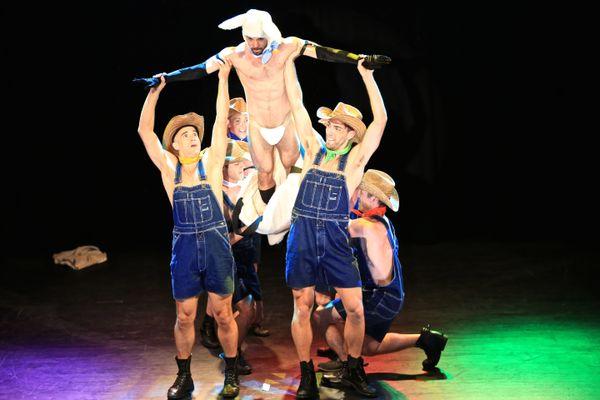 "Matthew Steffens, Judah Frank, Tom Feeney and the company of ""Broadway Bares Fire Island."""