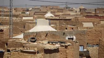 "A view of the indigenous Sahrawi refugee camp, Al Smara, in Tindouf, southern Algeria March 4, 2016. In refugee camps near the town of Tindouf in arid southern Algeria, conditions are hard for indigenous Sahrawi residents. Residents use car batteries for electricity at night and depend on humanitarian aid to get by. The five camps near Tindouf are home to an estimated 165,000 Sahrawi refugees from the disputed region of Western Sahara, according to the United Nations refugee agency UNHCR. REUTERS/Zohra Bensemra SEARCH ""THE WIDER IMAGE"" FOR ALL STORIES  Matching text ALGERIA-SAHARA/"