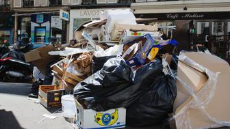 This picture taken on June 9, 2016 shows rubbish bins in the Pigalle district in Paris. One day before the start of Euro 2016 in France, rubbish piled up in parts of Paris on June 9, 2016 and trains were disrupted as strikes and political turmoil over labour reforms dragged on. The piles of uncollected household rubbish accumulating in parts of the capital, giving off a foul smell as the temperatures rise, was hardly the image of France that the Euro 2016 organisers want to convey.  / AFP / GEOFFROY VAN DER HASSELT        (Photo credit should read GEOFFROY VAN DER HASSELT/AFP/Getty Images)