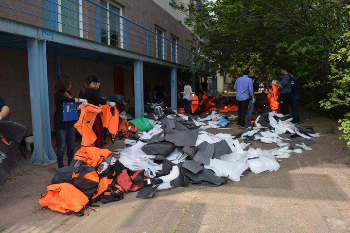 Students, staff and volunteers take the foam out of discarded life jackets.