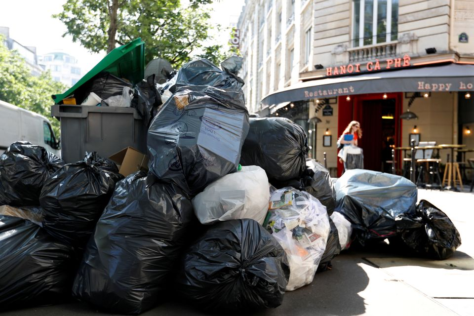 Rubbish bags are seen piled up on Paris' Grands Boulevards on Thursday.