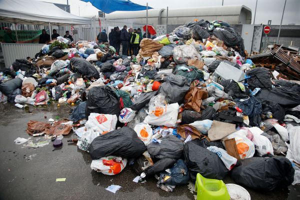 Striking French CGT labor union garbage collectors and sewer workers block access to the waste treatment center of Ivry-sur-S