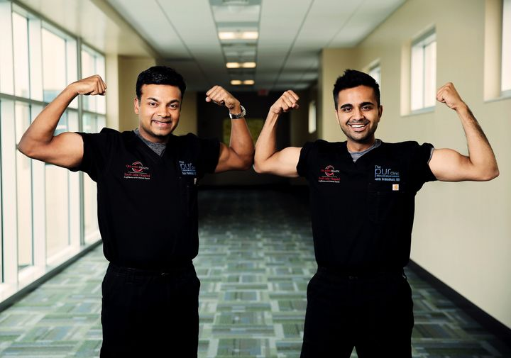 Dr. Sijo Parekattil and Dr. Jamin Brahmbhatt show off their muscles and combined 90-pound weight loss in a photo to promote t