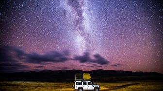 Sani Pass, Lesotho -car sets up camp for the evening beneath the stars.