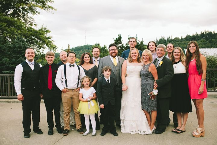 """The author with """"dad number one,"""" her mom and family at her 2014 wedding."""