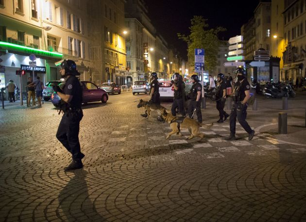 Police patrols on a street following the