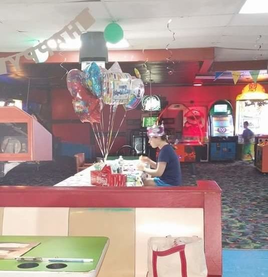 Hallee pictured apparently alone at her 18th birthday party last
