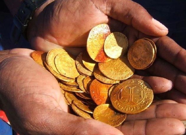 Some of the gold coins found amidst the wreckage of the ship - most of which are in mint