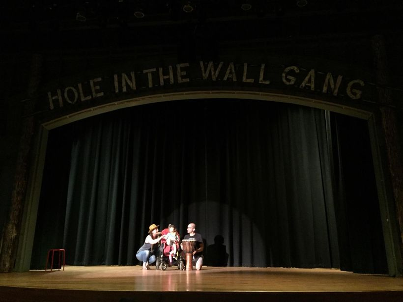 Esmé on the stage at Hole in the Wall Gang Camp