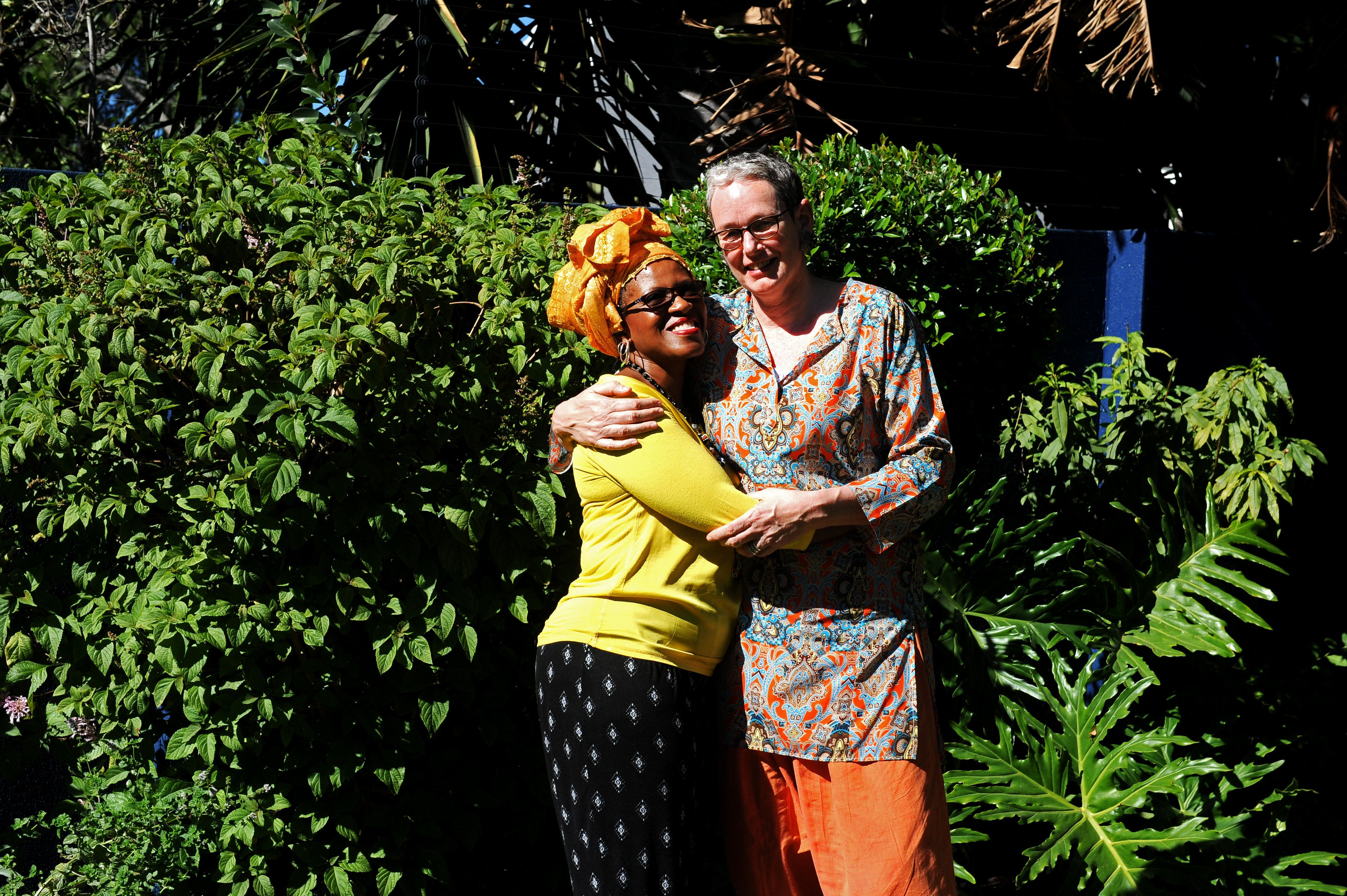 CAPE TOWN, SOUTH AFRICA  MARCH 12 (SOUTH AFRICA OUT): The daughter of Archbishop Emeritus Tutu, Reverend Mpho Tutu and her wife, Professor Marceline Furth embrace during an interview on March 12, 2016 at their home in Cape Town, South Africa. The two celebrated their union in an intimate wedding ceremony. (Photo by Lerato Maduna/Foto24/Gallo Images/ Getty Images)