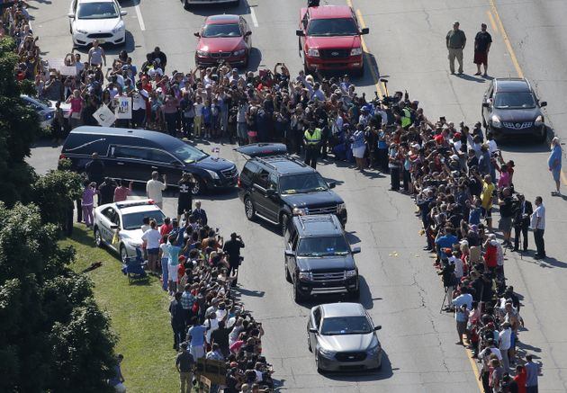 The hearse (center, L) carrying the remains of Muhammad Ali leaves the A D Porter & Sons funeral...