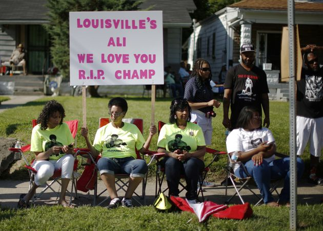 Jackie Hughes (L), Terry Shumake (2nd from L) and Vicki Carter (3rd from L) gather for the funeral procession...