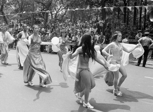 Young women dance downFifth Avenue at the 1972 Puerto Rican Day Parade.
