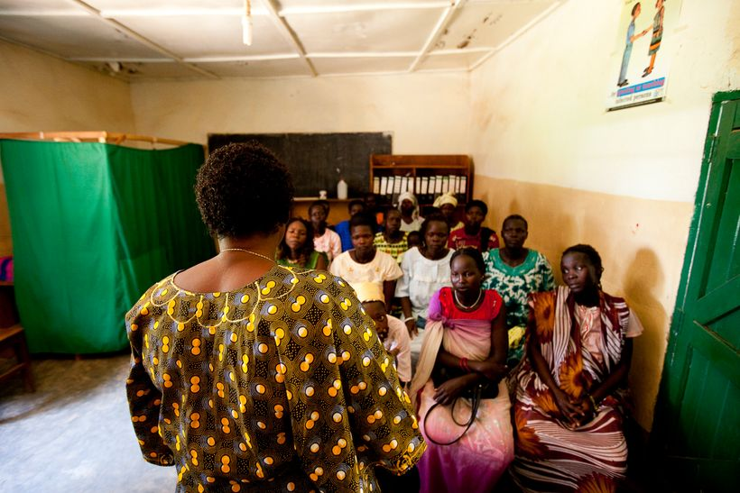 A nurse at the Saint Bakhita Health Centre in Yei discusses family planning and HIV counseling and testing with clients befor
