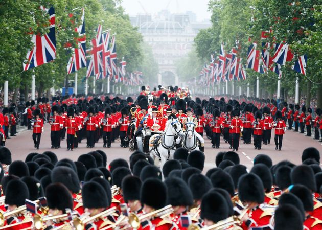 Queen Elizabeth II and Prince Philip return to Buckingham Palace after attending the Trooping the Colour...