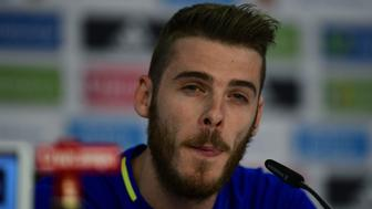 Spain's goalkeeper David De Gea listens during a press conference in Saint Martin de Re's stadium on June 10, 2016, prior the start of the Euro 2016 football tournament. / AFP / PIERRE-PHILIPPE MARCOU        (Photo credit should read PIERRE-PHILIPPE MARCOU/AFP/Getty Images)