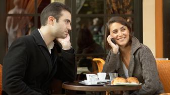 Couple at Outdoor Cafe, Woman Talking on Cell Phone, Paris, France