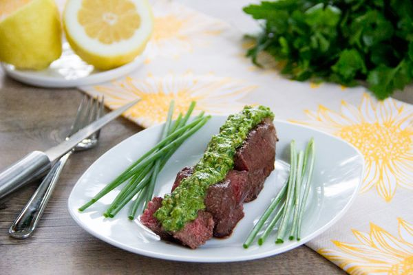 "<strong>Get the <a href=""http://thescrumptiouspumpkin.com/2012/06/04/grilled-sirloin-with-lemon-chive-pesto/"" target=""_blank"""