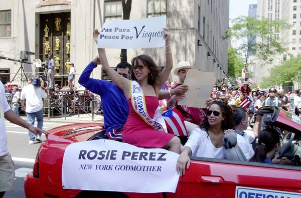 """Actress Rosie Perez holds up a sign calling for peace for <a href=""""http://www.cbsnews.com/news/no-peace-on-vieques/"""" target="""""""