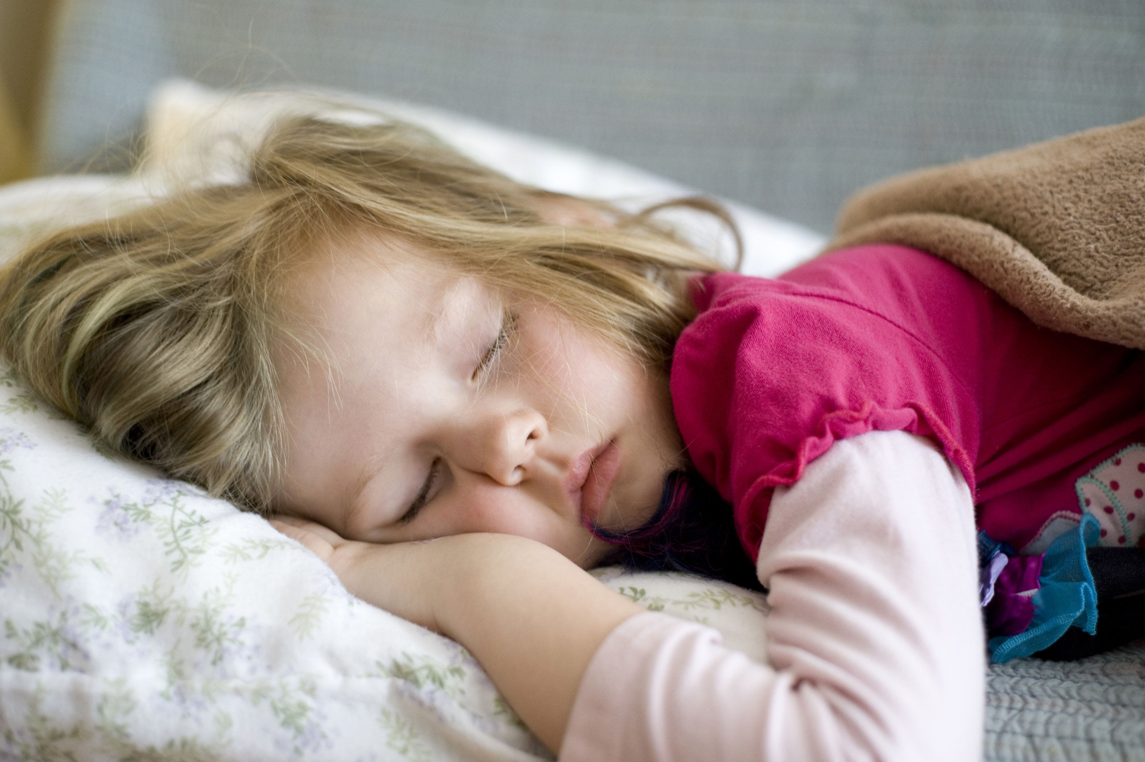 Candid Portrait of Girl Napping on Couch