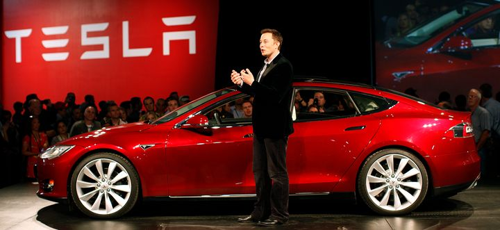Tesla Motors CEO Elon Musk speaks next to the Model S during an event at the Tesla factory in Fremont, California, on Oc