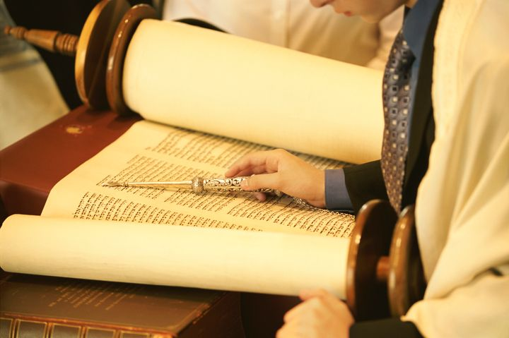 The Torah isan ancient Jewish text that is a central part of the faith.