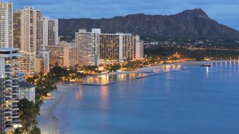 Scenic view of Honolulu city, Diamond Head and Waikiki Beach at night; Hawaii, USA