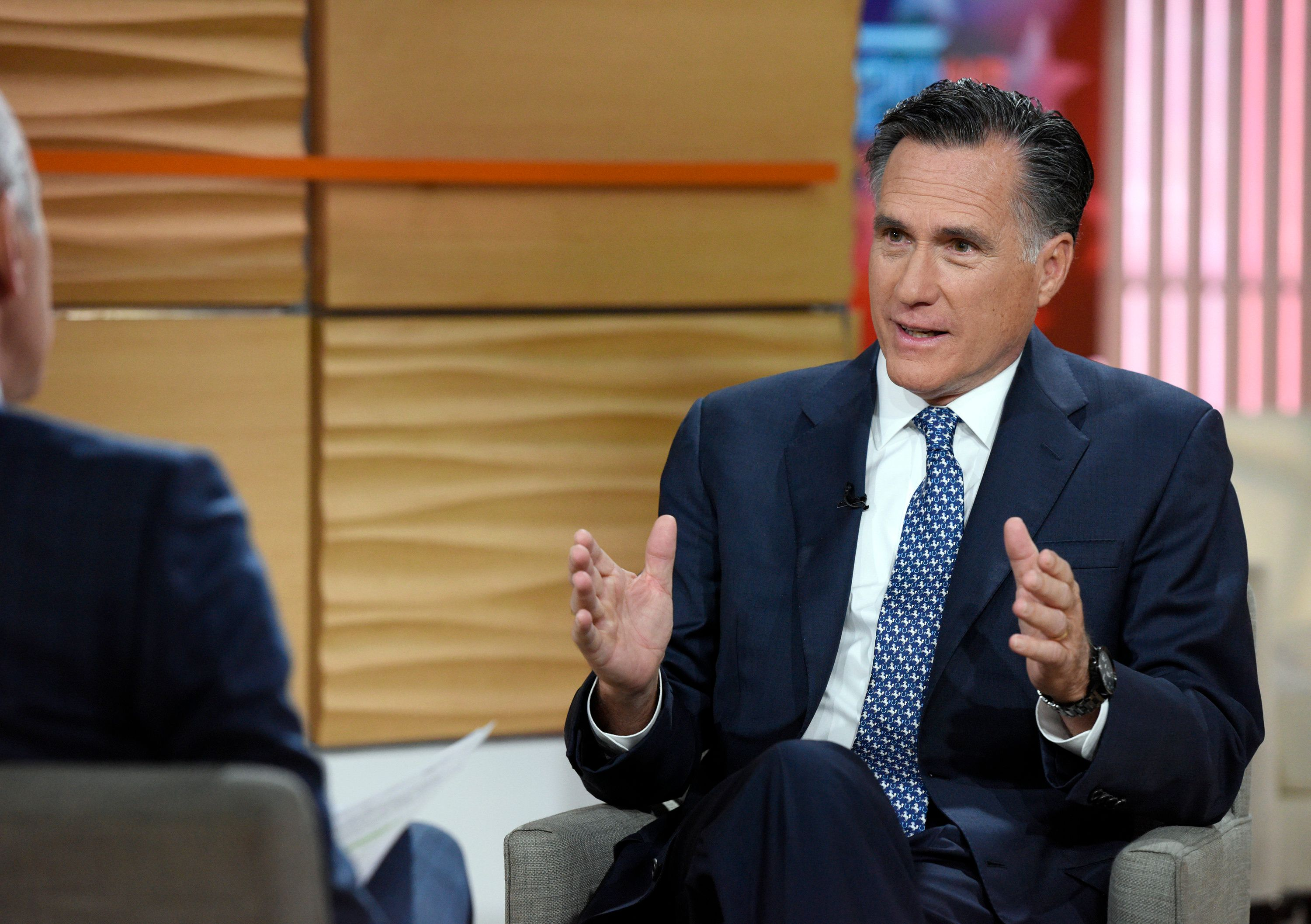 Mitt Romney doesn't want to be associated with Donald Trump's racist campaign.