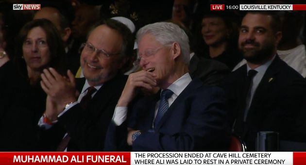 Bill Clinton (right) was caught on camera smiling as he spoke to actor Billy Crystal during the