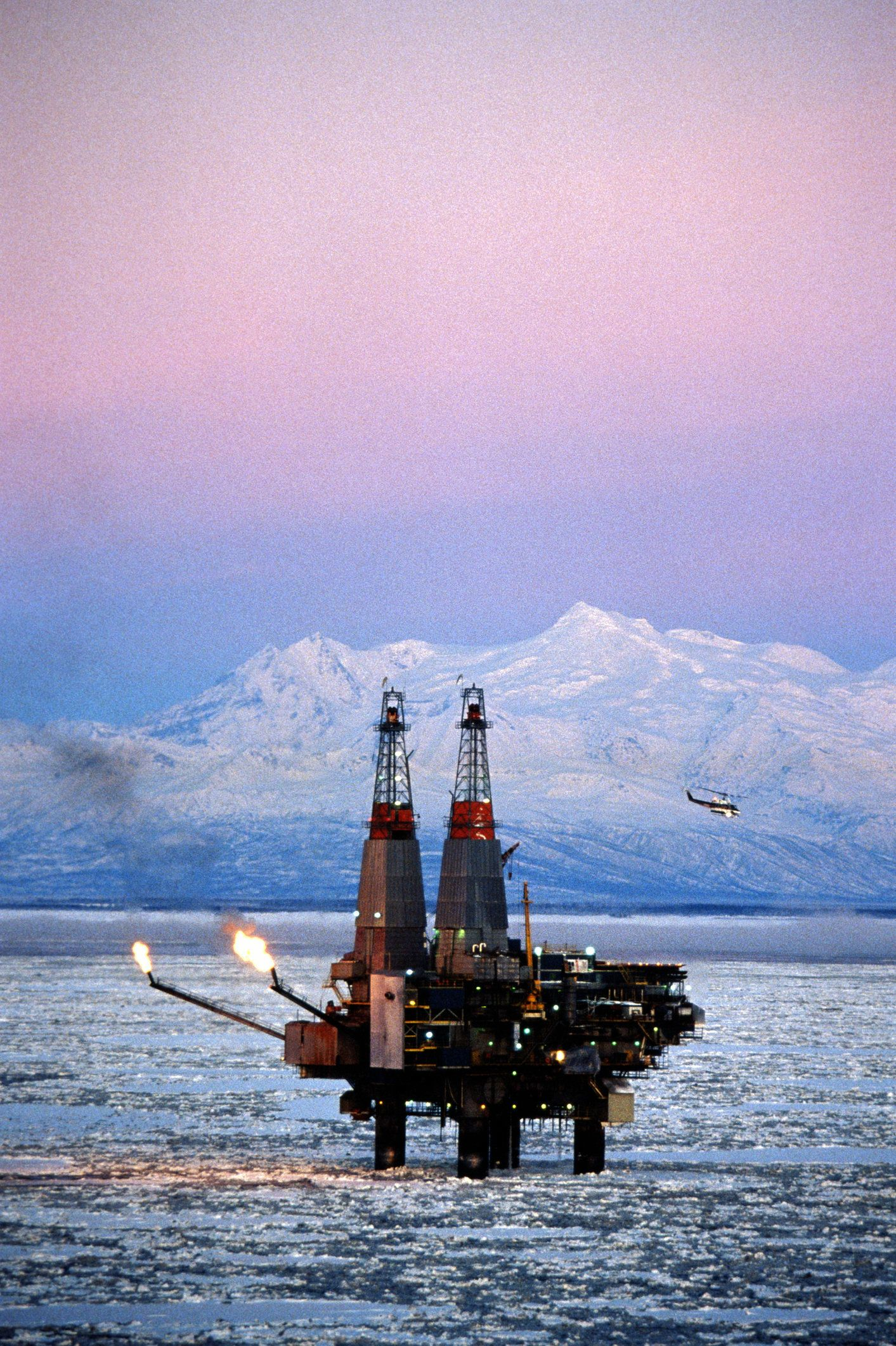 Mt.Spurr in background. Oilfields located under the sea are located and exploited by the construction and operation of offshore oil rigs.