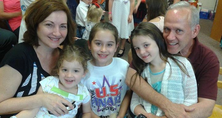 Joanne and Steve Bryant with their granddaughters.