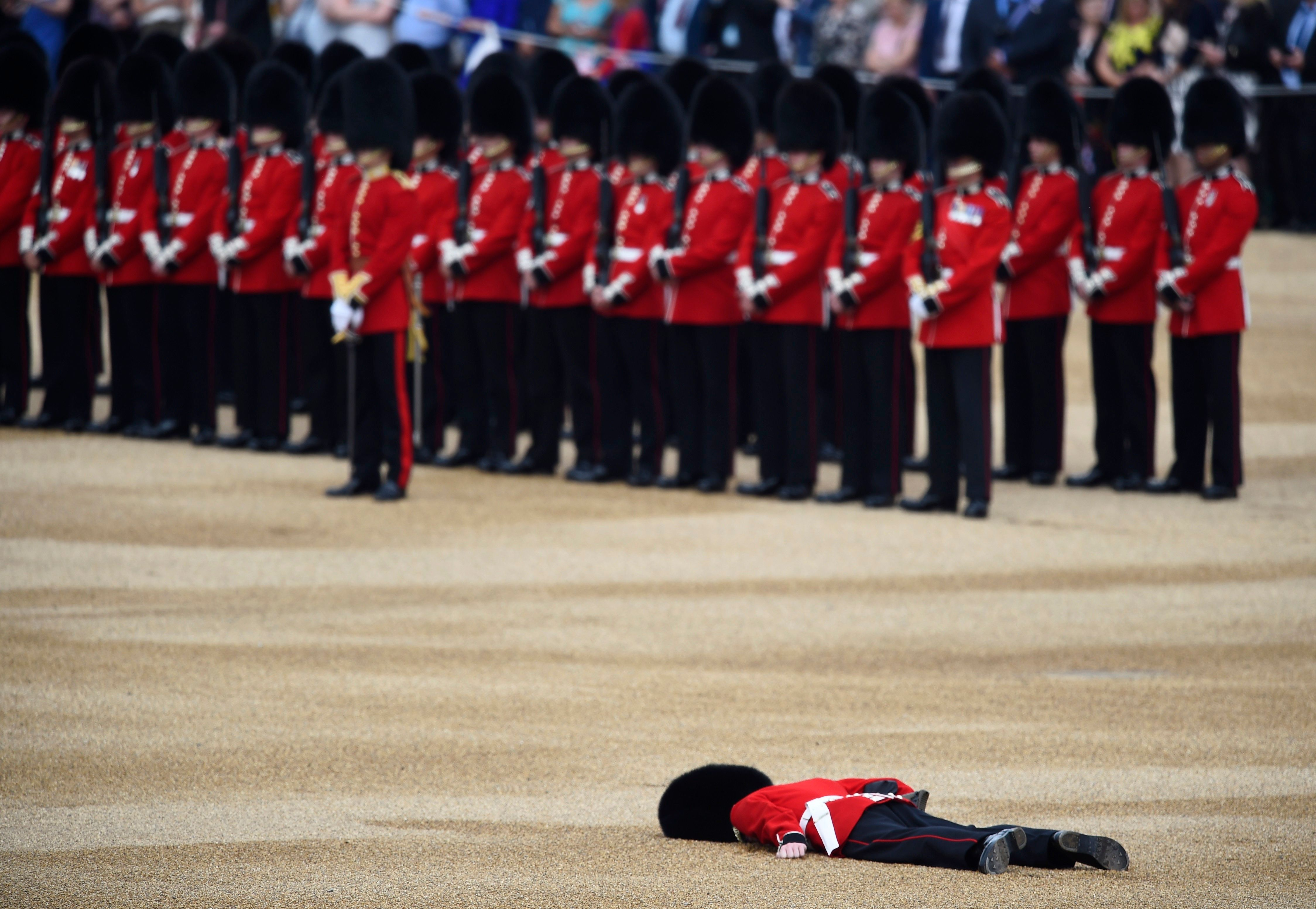 Soldier Collapses Face-Down In Middle Of Trooping The