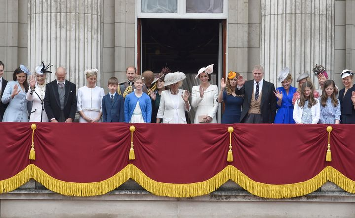 Members of the royal family wait on the balcony of Buckingham Palace for Queen Elizabeth to return after the Trooping the Colour ceremony.
