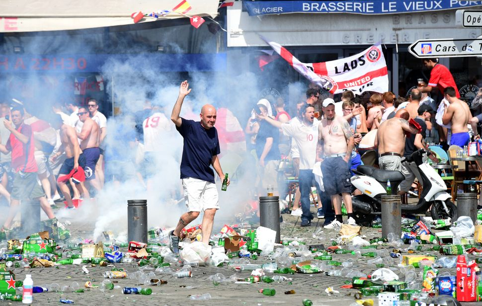 Tear gas is fired at England fans as they gather in the city of Marseille, southern France, on June 11, 2016, ahead of the Eu