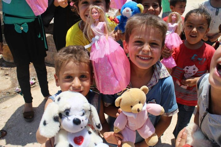 Adham's charity organization delivers toys to children in Aleppo several times per year.