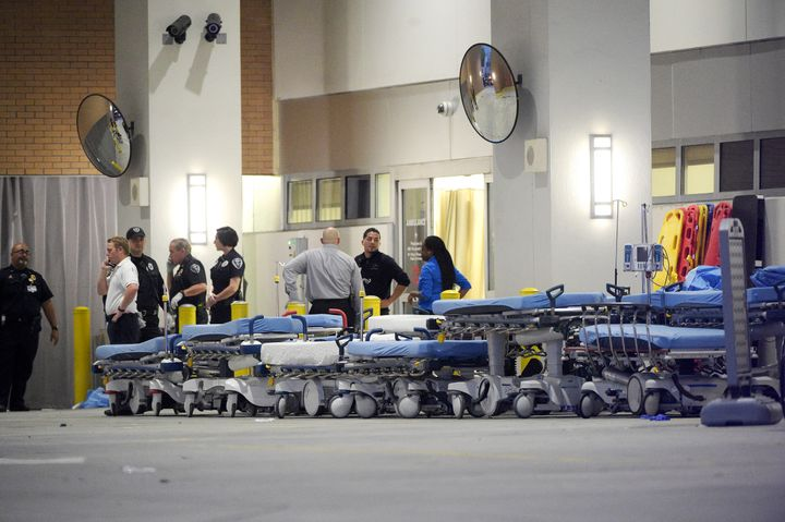 Emergency personnel wait with stretchers at the emergency entrance to Orlando Regional Medical Center hospital for the arriva