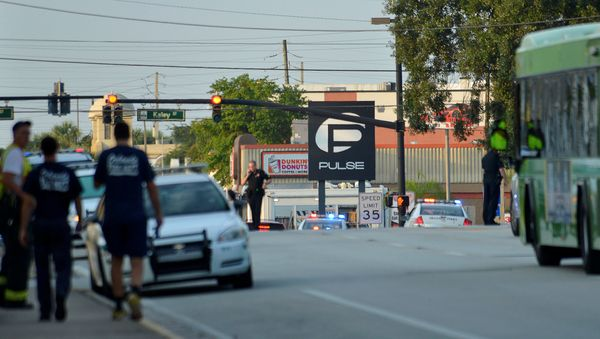 Police lock down Orange Avenue around Pulse nightclub, where people were killed by a gunman in a shooting rampage in Orlando,