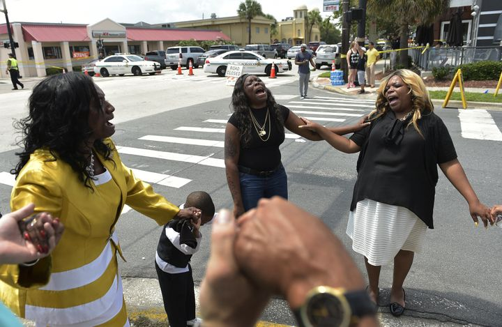 Women pray outside Pulse nightclub on Sunday, the day of the shooting.