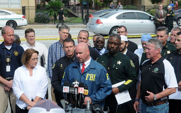 FBI assistant special agent in charge Ron Hopper (C), law enforcement and local community leaders speak during a press confer