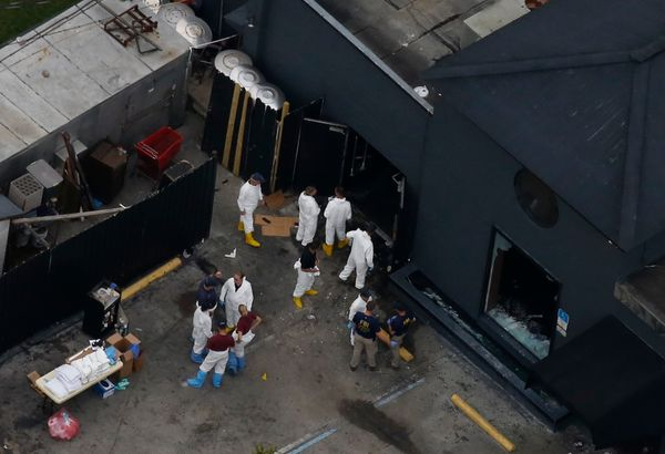 Police forensics investigators work at the crime scene of a mass shooting at the Pulse gay night club in Orlando, Florida, U.