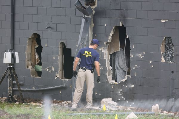FBI agents investigate the damaged rear wall of the Pulse Nightclub where Omar Mateen allegedly killed at least 50 people on
