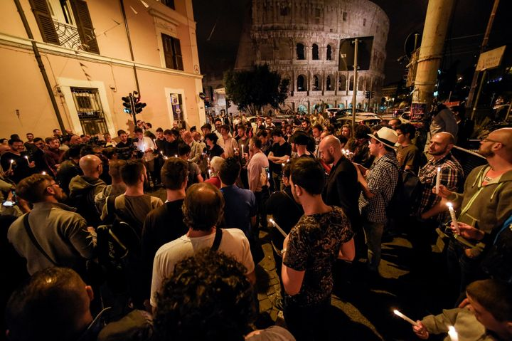 Outside the Colosseum in Rome, LGBT rights supporters hold candles in memory of the victims of the Orlando shooting.