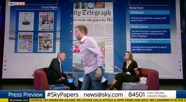 Owen Jones walks off the set of the Sky Papers review as Mark Longhurst (left) and Julia Hartley Brewer...