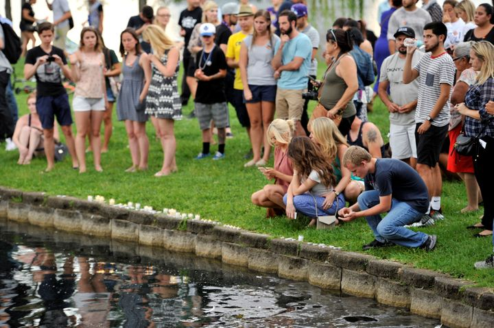 Orlando residents light candles during a vigil at Lake Eola Park for victims of the shooting.