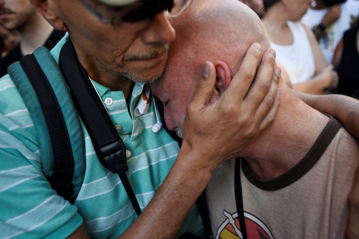 Todd Fernandez cries after a vigil outside The Stonewall Inn on Christopher Street.