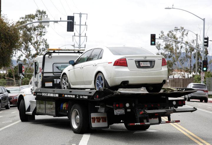 A vehicle that reportedly belonged to James Wesley Howell is towed in Santa Monica, California, on Sunday.