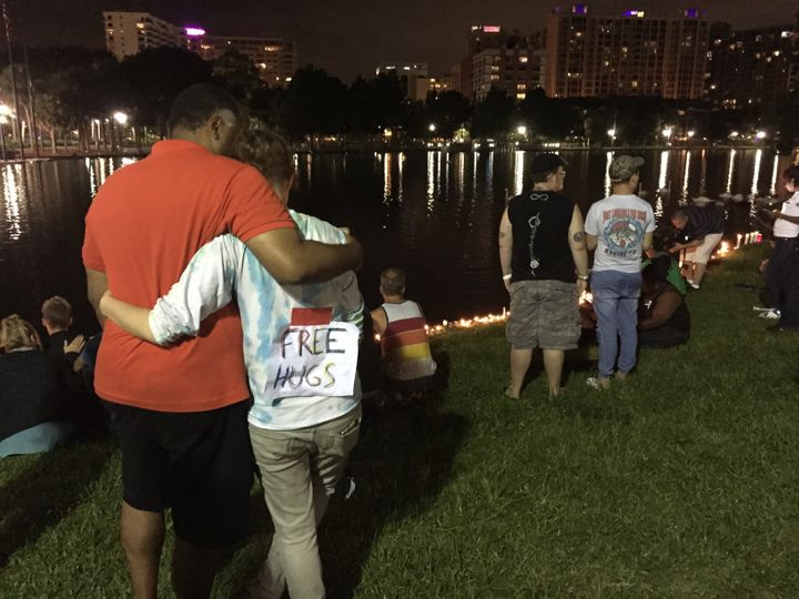 People gather at Lake Eola Park to remember the victims.
